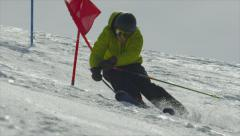 SLOW MOTION: Slalom skier turning around the gates Stock Footage