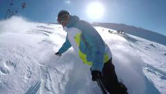 SELFIE: Snowboarder riding powder snow in mountain ski resort Stock Footage