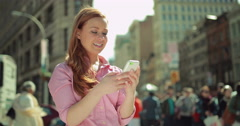 Young caucasian woman in city texting cell phone Stock Footage