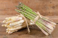 Bunch of fresh green and white asparagus - stock photo