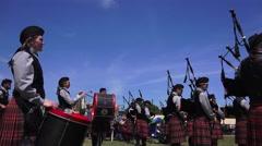 Scottish drummers ,blue sky, tilt - stock footage