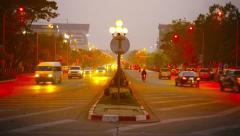 VIENTIANE, LAOS - CIRCA DEC 2013: Moderate traffic along a beautifully illumi Stock Footage