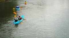 VANG VIENG, LAOS - CIRCA DEC 2013: Big group of tourists kayaking along the N Stock Footage