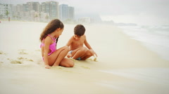 Children playing in sand on a beach Stock Footage