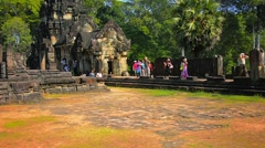 SIEM REAP, CAMBODIA - CIRCA DEC 2013: Tourists strolling through the ancient Stock Footage