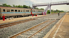 BANG PA-IN, THAILAND - CIRCA NOV 2013: Passenger train accelerates out of the Stock Footage