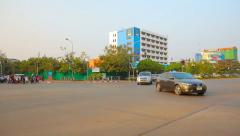 VIENTIANE, LAOS - CIRCA DEC 2013: Light morning traffic at a typical urban in Stock Footage