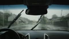 SLOW MOTION: Wiping raindrops off a windshield in a car Stock Footage