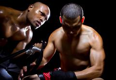 Trainer Motivating a Boxer or MMA Fighter - stock photo