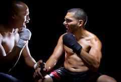 Trainer Motivating a Boxer or MMA Fighter Stock Photos