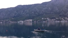 Man in a rowboat in Kotor Montenegro - stock footage