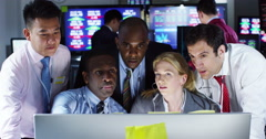 4K Team of financial brokers watching the world markets in a busy trading room Stock Footage