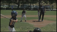 Little League coach pitch game, kids age 7-9. View from behind the catcher. Stock Footage