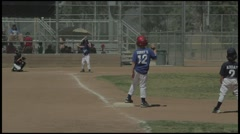 Little Leaguers playing coach pitch baseball ages 7-9. Base Hit. Stock Footage