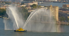 Fire tug boat tugboat spraying water hose jets aerial top view ship Rotterdam Stock Footage