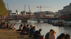 People Socialising, Sitting by Water, Bristol Harbour Side HD Stock Footage