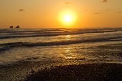 Breathtaking view of amazing sunset in beautiful beach, Manabi, Ecuador Stock Photos