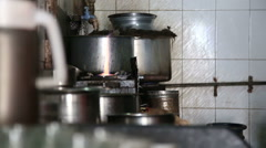 Pot on the gas stove in a kitchen. - stock footage