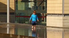 Boy Playing in Water at Millennium Square Bristol HD Stock Footage