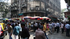 Socialist building in a busy street in Mumbai. - stock footage