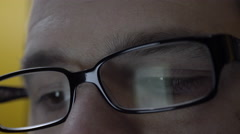 Reflection of smartphone on mans eyeglasses. 4K UHD. Stock Footage