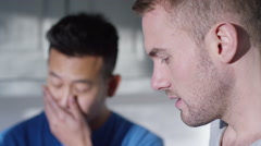 4K Relationship troubles. Portrait of gay couple having emotional conversation Stock Footage