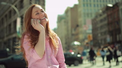 Young caucasian woman in city talking on cell phone - stock footage