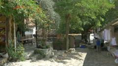 Shady stone paved street Sirince Turkey tourists - 4K UHD 0355 Stock Footage