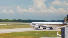 4K Cityscape, Singapore airport, plane moving on runway to take off point. Stock Footage