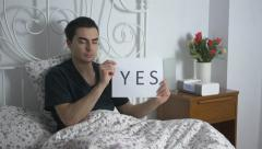 4K YES Sign Being Showed Man In Bed Stock Footage