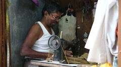 Portrait of Indian man working on a sewing machine. Stock Footage
