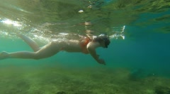 Girl tries to dive in the sea is transparent Stock Footage