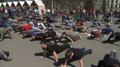 Many young people do exercises in the city Stock Footage