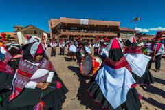 musicians and dancers in the peruvian Andes at Puno Peru - stock photo