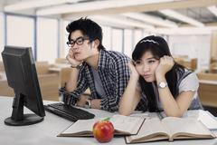 Students bored in the class room - stock photo