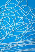 Abstract white wool strings on blue background - stock photo