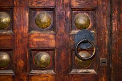 An old door with circle iron door-handle Kuvituskuvat