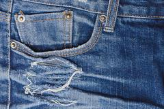 Old perforated jeans closeup - stock photo