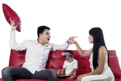 Two furious parents while quarreling - stock photo