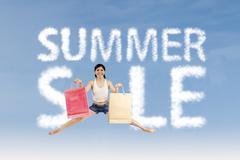 Woman make summer sale sign Stock Photos