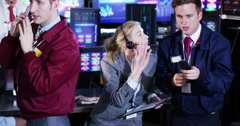 4K Timelapse of city stockmarket traders, at work in a chaotic trading room - stock footage