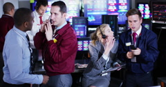 4K Timelapse of city stockmarket traders, at work in a chaotic trading room Stock Footage