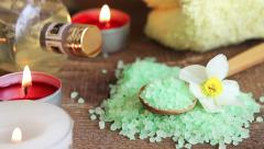 Bath salt, massage oil and candles for spa Stock Footage