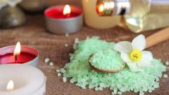 Spa salt scrub, massage oil and candles Stock Footage