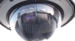 Dome camera, sky, clouds and cars reflection Stock Footage