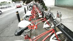 A row of red bikes from Mexico City's Ecobici Stock Footage