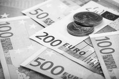 Closeup of euro banknotes and coins - stock photo