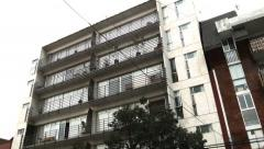 Stock Video Footage of Establishing shot from a tall modern apartment building in Mexico City