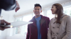 4K Young couple with real estate agent, looking at home to buy or rent - stock footage