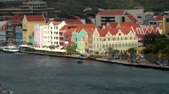 Curacao Willemstad 062 world cultural heritage Punda downtown with ship on river Stock Footage